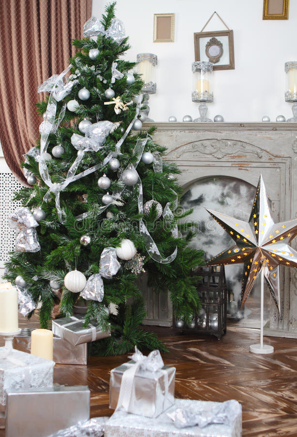 Daily interior in light tones decked out with Christmas tree royalty free stock photography
