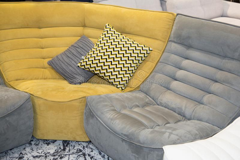 Interior living room with large angle sofa a yellow green grey couch. Home interior living room with large angle sofa a yellow green grey couch royalty free stock photography