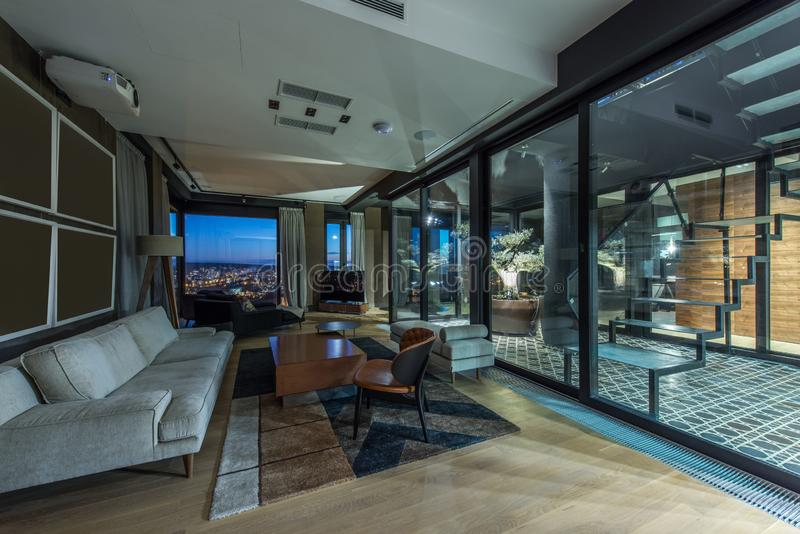 Interior of a living room in a luxury penthouse stock image