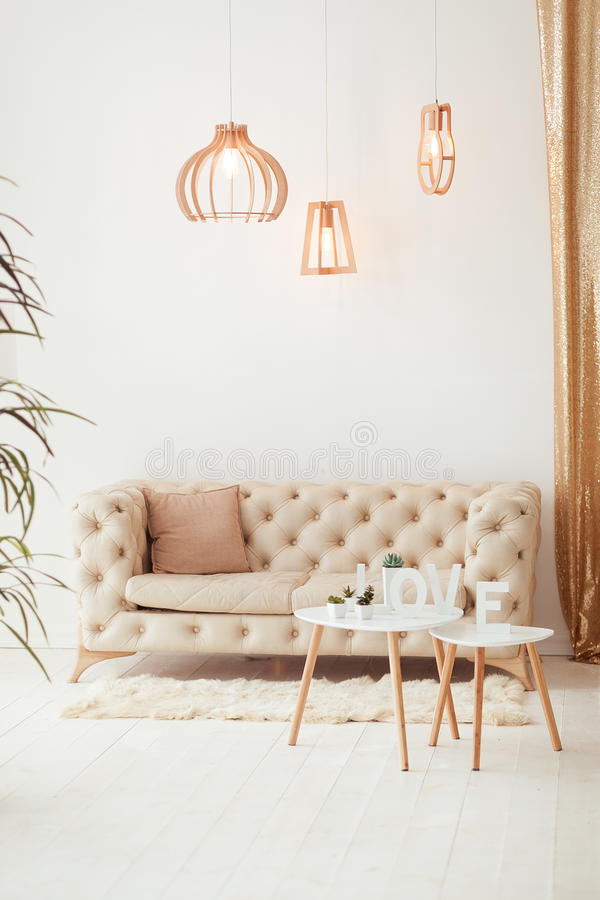 Interior living room with a sofa, table, floor lamp and panoramic window. Beautiful Living room Architecture Stock. Images, Photos of Living room. Interior stock images
