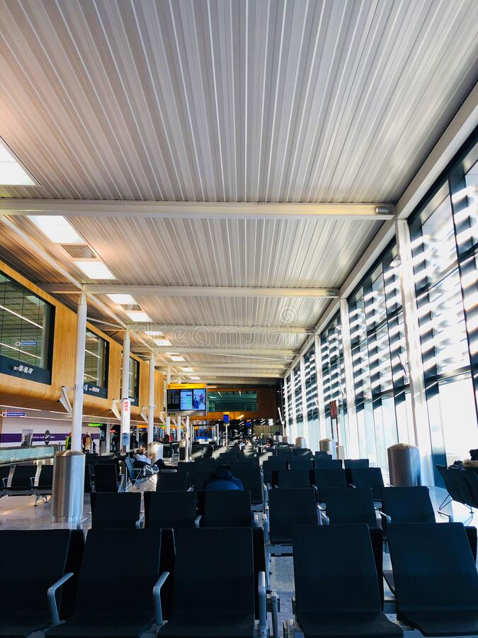 Interior of London Heathrow Airport. Chairs for sitting at London Heathrow Airport royalty free stock photography