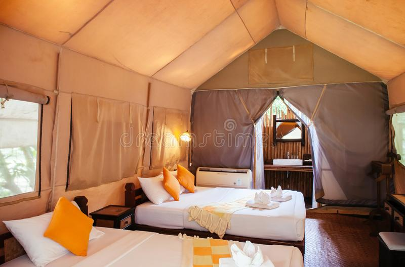 Interior of luxurious camping resort in nature forest, glamping royalty free stock photo