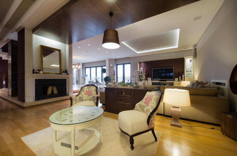 Interior of a luxury apartment with fireplace royalty free stock photos