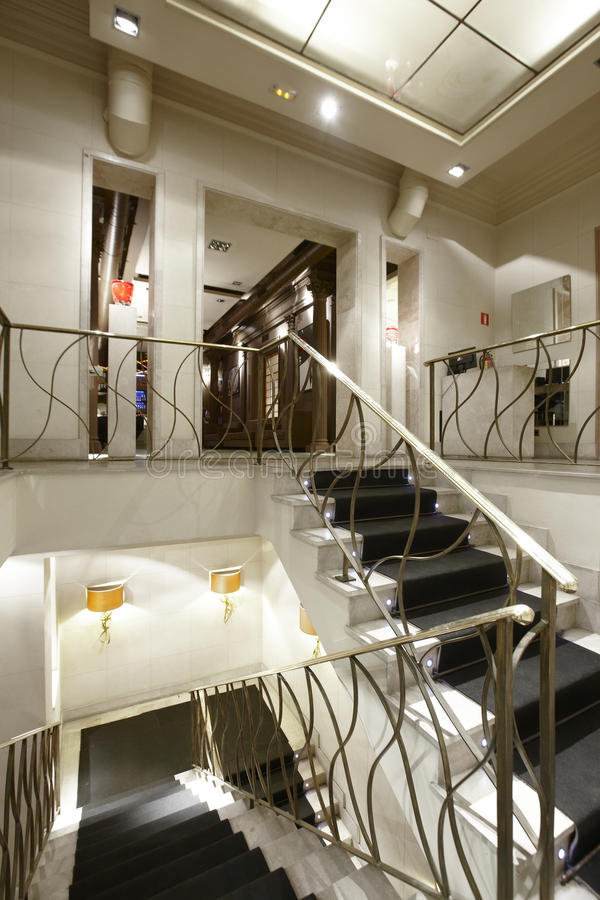 Interior luxury apartment with illuminated stair. royalty free stock image