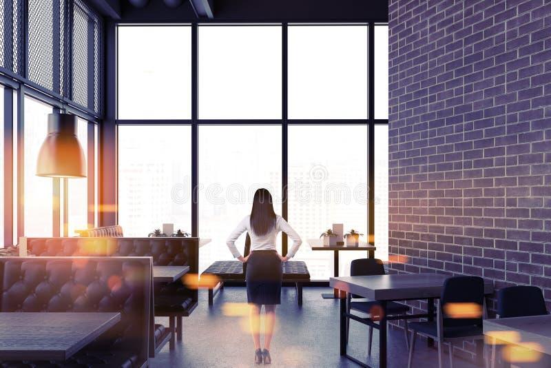 Luxury brick restaurant interior, businesswoman stock images