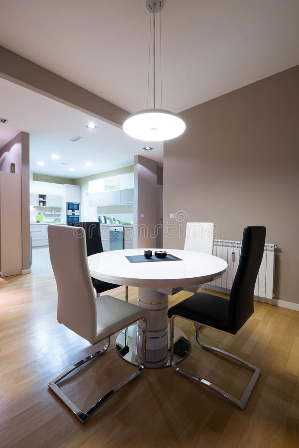 Interior of a luxury dining room with round table and a view to stock photos