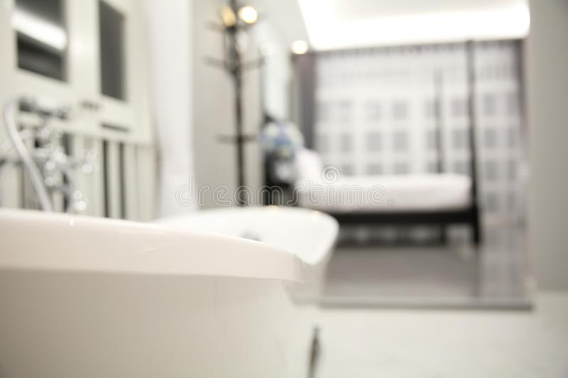 Interior of a luxury hotel bedroom. In white room stock image