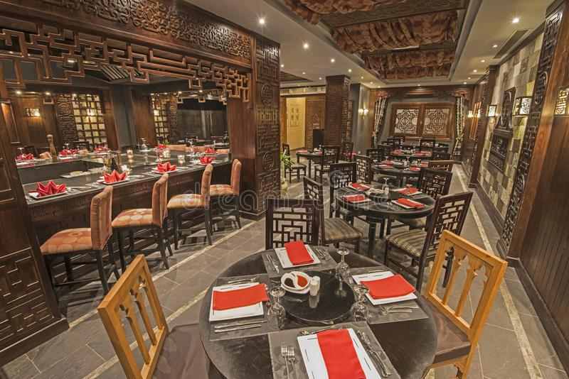 Interior of a luxury hotel Asian restaurant. Interior design of a luxury hotel resort Asian restaurant dining area with ornate decor stock photo