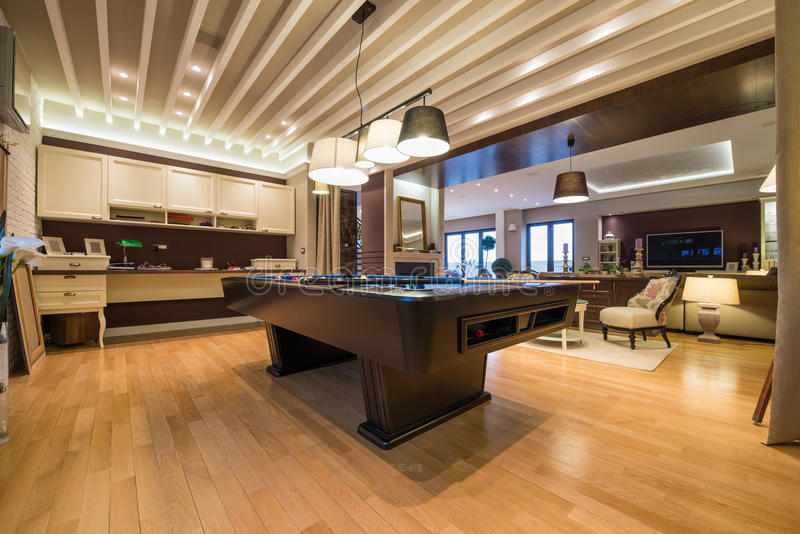 Interior of a luxury living room with pool table stock for Domestic bar design