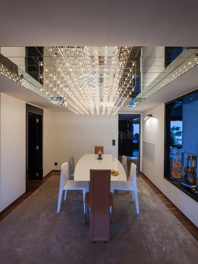 Interior of a luxury modern villa, dining room. Interior of a luxury modern villa, nobody stock photos