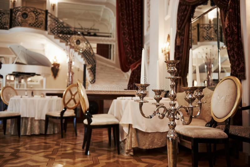 Interior of luxury restaurant in vintage aristocratic style with piano on the stage royalty free stock photos