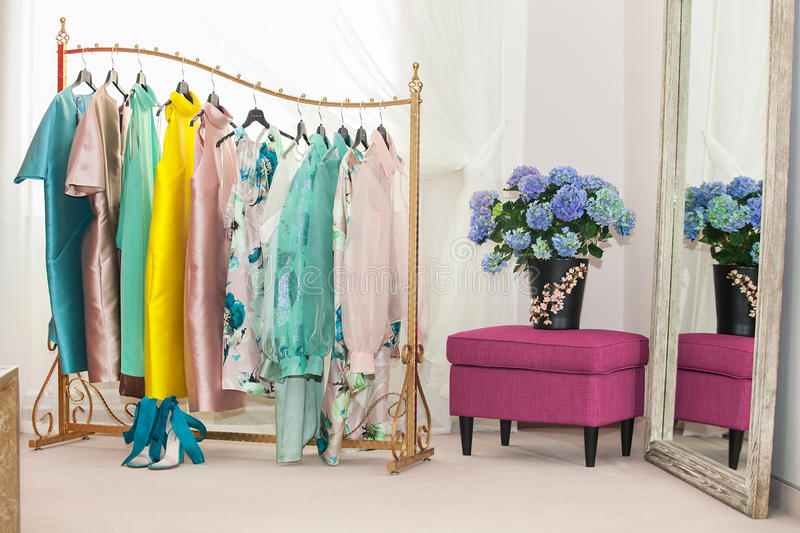 Interior of the luxury shop. Of fashionable clothes stock image
