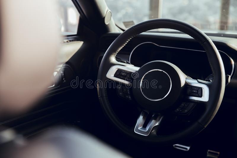 Steering wheel of luxury car stock image