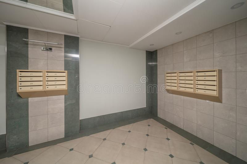Interior with mailboxes. Empty hall luxury interior with mailboxes on wall stock images