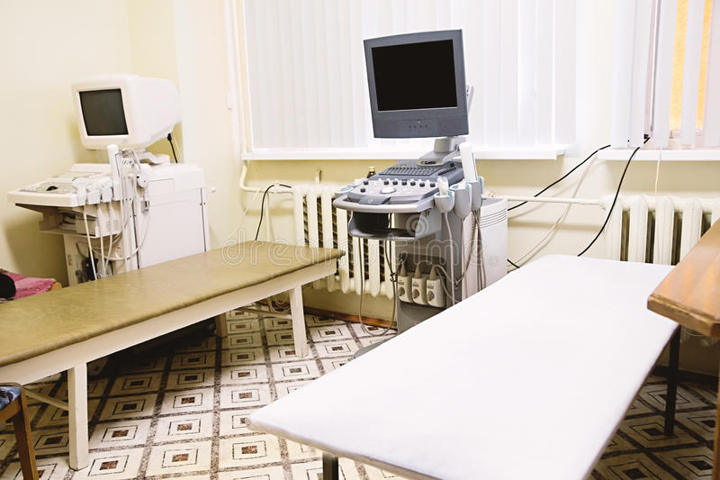 Interior of medical room with ultrasound diagnostic equipment. Photo of Interior of medical room with ultrasound diagnostic equipment stock image