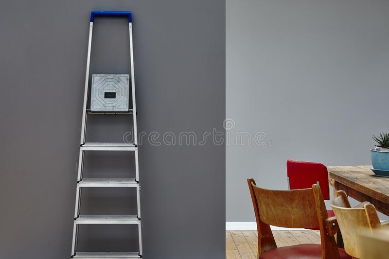 Interior mix dining table with ladder house moving party royalty free stock photography