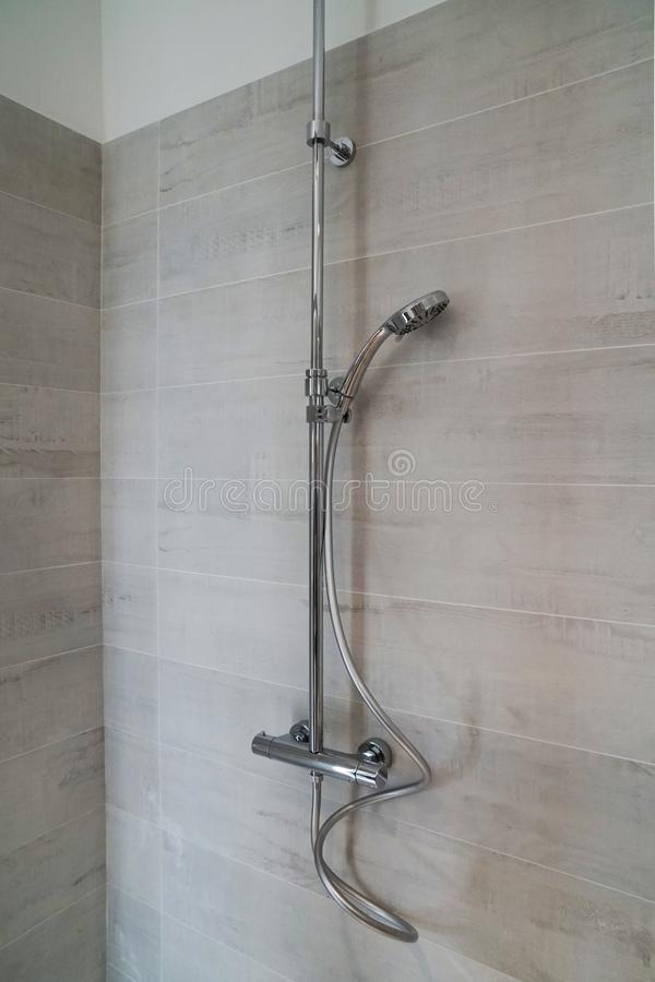 Mixer tap shower with adjustable wand. Interior: Mixer tap shower with adjustable wand royalty free stock photography