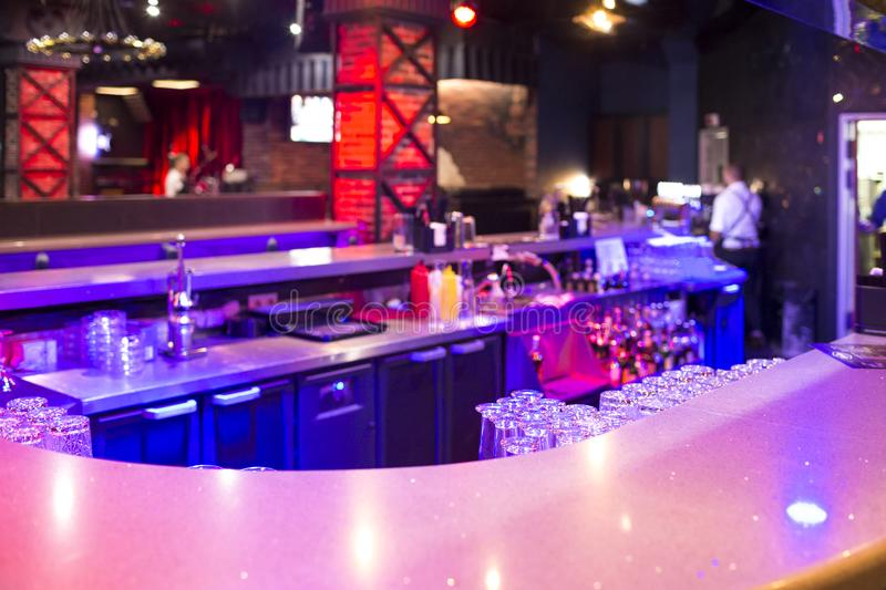 Interior of Modern Bar counter with Line of Glasses and Bottles stock images