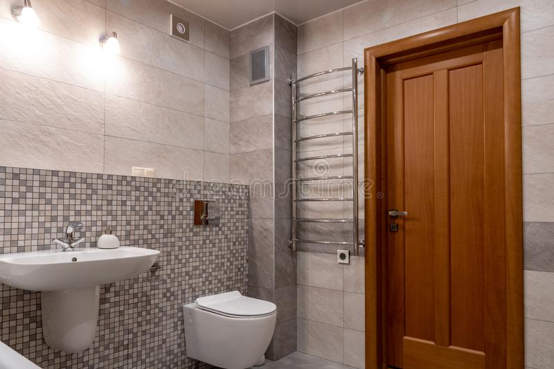 Interior of modern bathroom with bath, shower and toilet. stock image