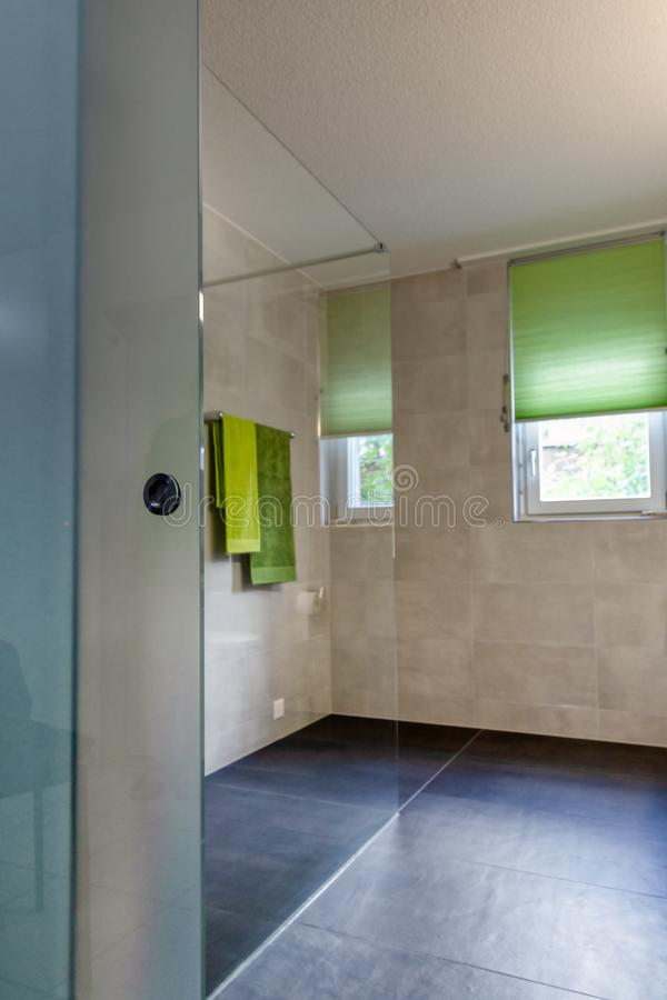 Interior of a modern bathroom with white furniture stock images
