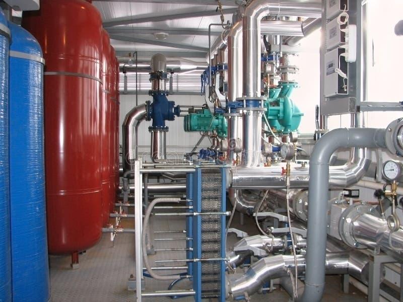 Interior of modern boiler-house. Pumps, pipelines and devices in an interior of modern boiler-house stock photos