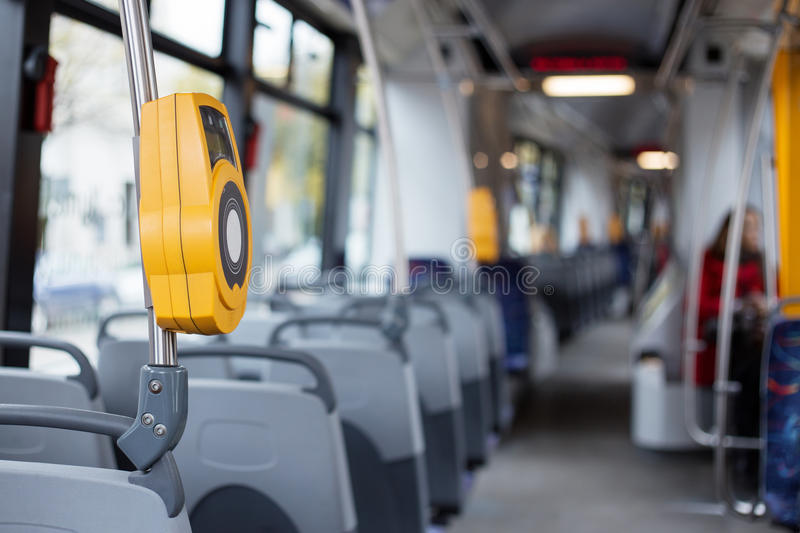 Interior of modern city tram. With electronic ticket validation machine royalty free stock photo