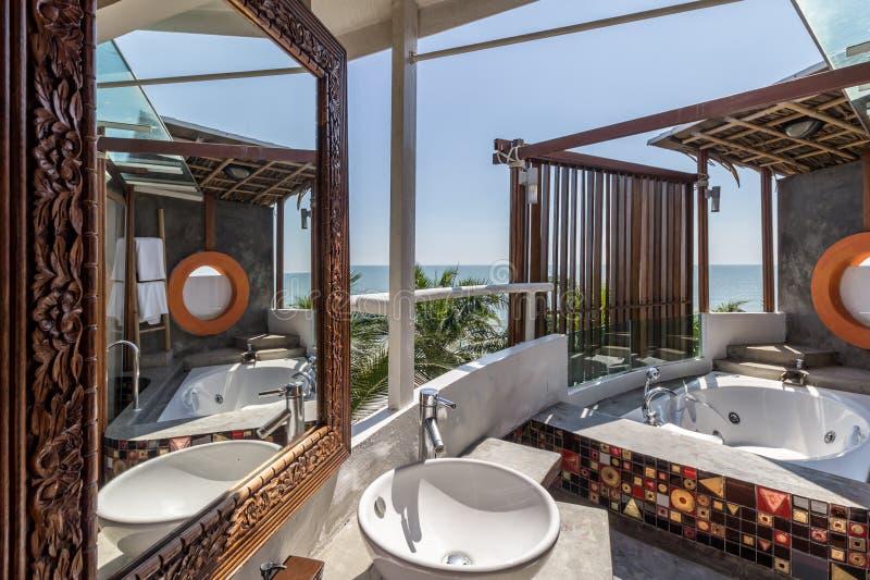 Interior of the modern design bathroom with sea view stock photos