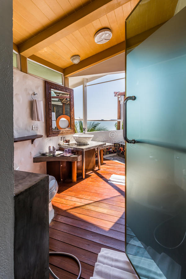 Interior of the modern design bathroom with sea view royalty free stock photography
