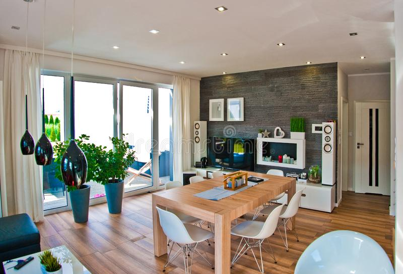 Wide angle view of modern living and dining room royalty free stock image
