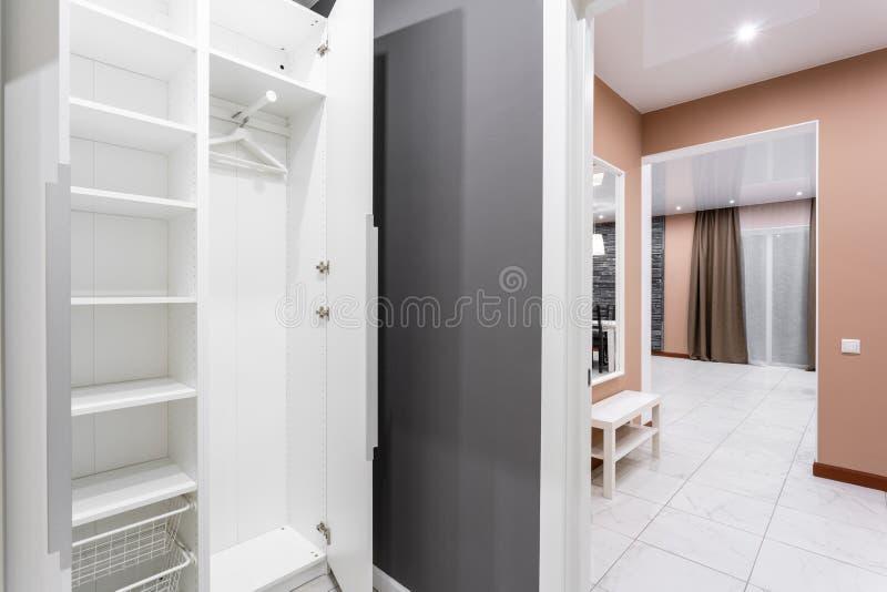 Interior of modern empty wardrobe room. Hotel modern standart room. simple and stylish interior. interior lighting royalty free stock photography
