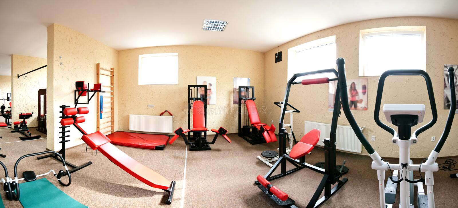 Interior of modern gym. Panoramic interior view of modern equipment in gym stock images