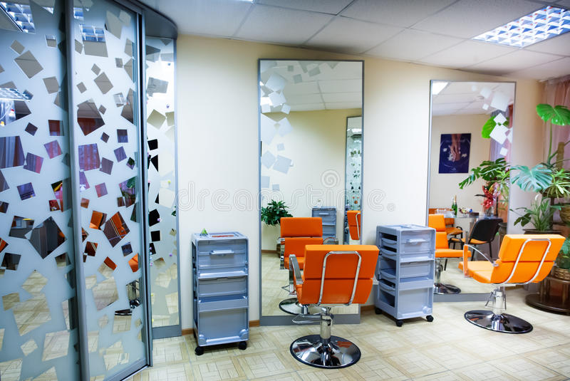 Interior of modern hair salon stock photography