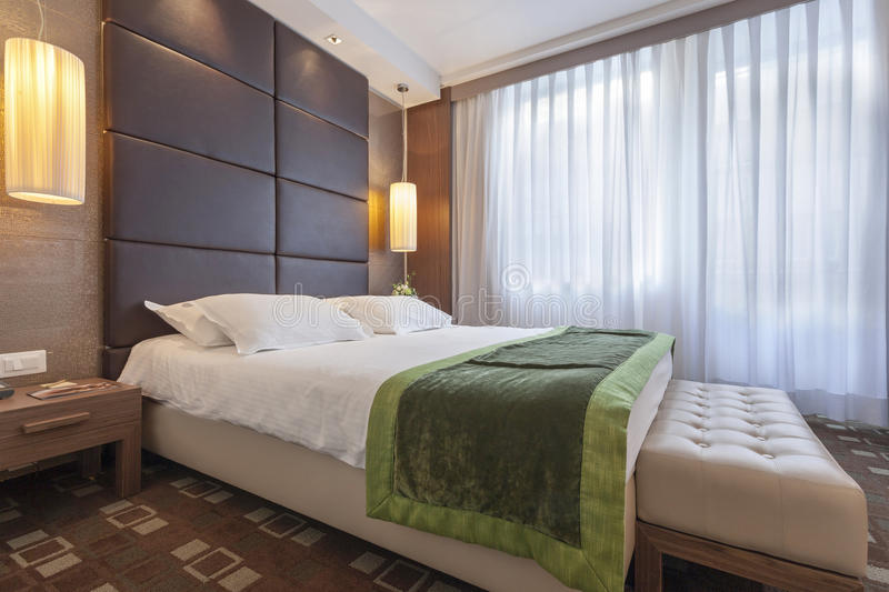 Interior of a modern hotel bedroom.  stock photo