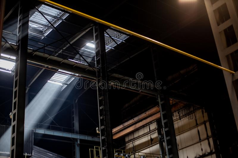 Interior of modern industrial production plant in beams of luminous lights royalty free stock image