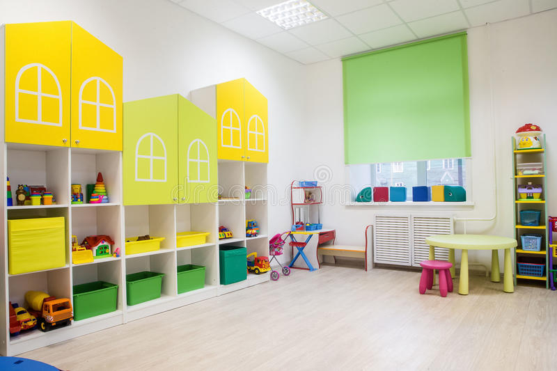 Minimalist Classroom Games ~ Interior of a modern kindergarten in yellow and green