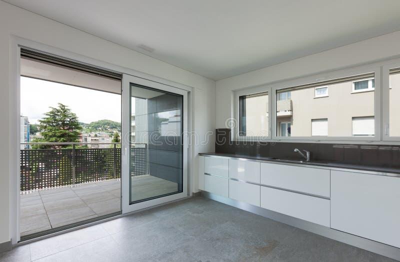 Interior, modern kitchen. Interior of empty apartment, modern kitchen royalty free stock images