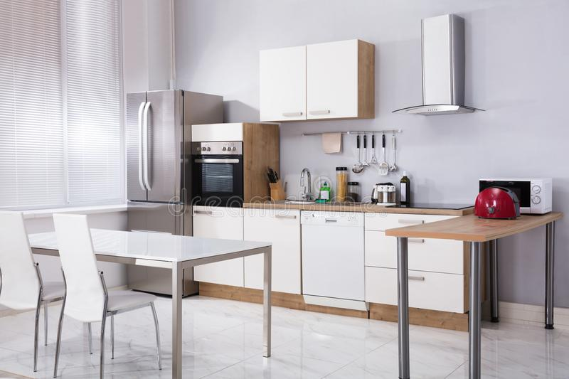 Interior Of Modern Kitchen. With Appliances At Home royalty free stock photography