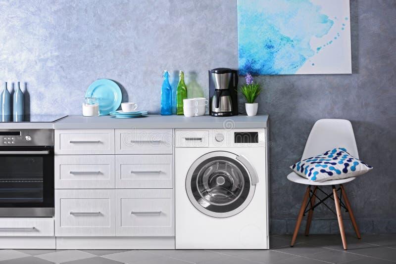 Interior of modern kitchen with washing machine. Laundry day stock photos