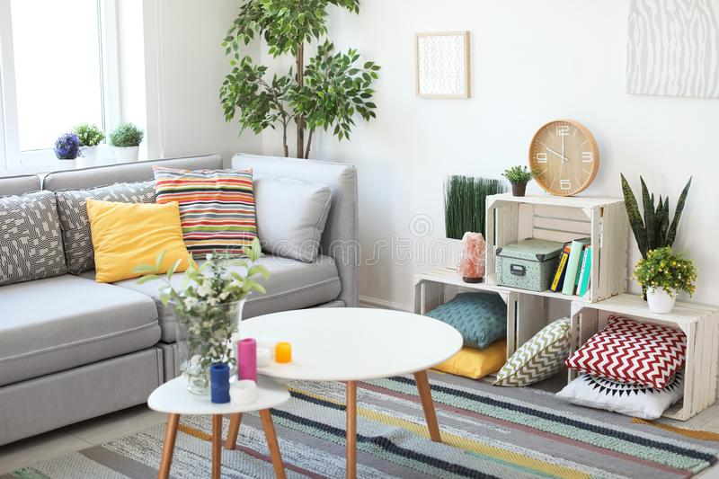 Interior of modern living room with pillows stock images