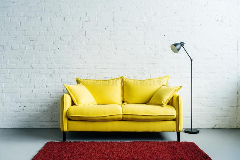 Interior of modern living room with rug, couch and floor royalty free stock photo