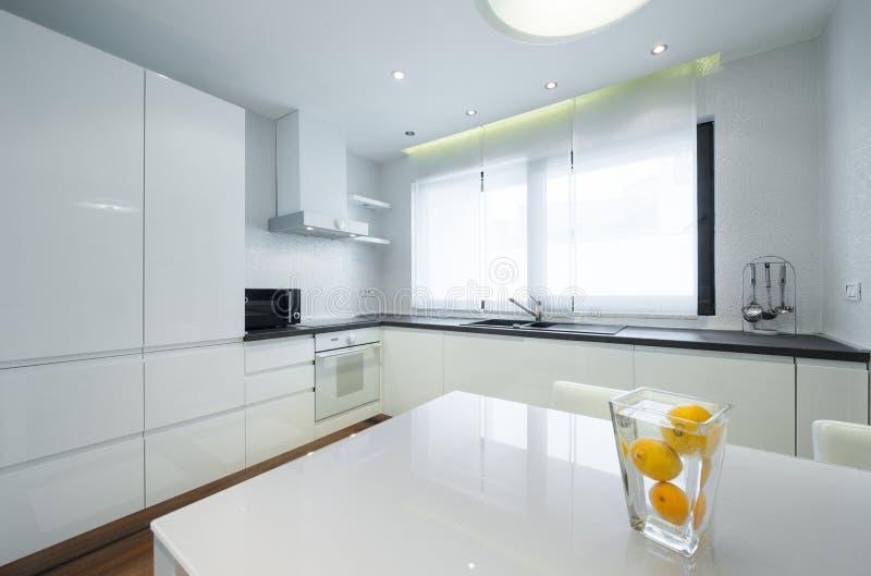 Interior of a modern luxury bright white kitchen stock photos
