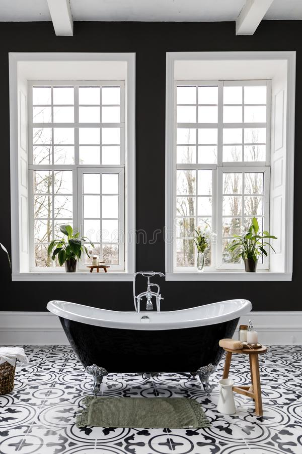 Interior of modern luxury minimalistic bathroom with window royalty free stock images