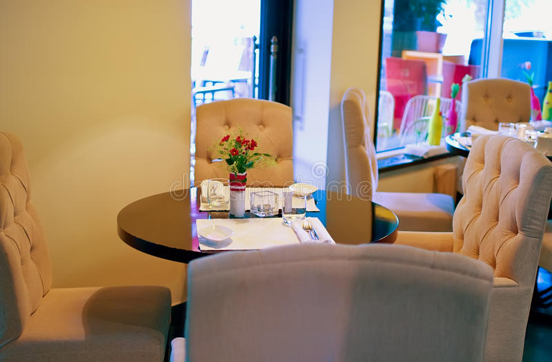 Interior of modern restaurant. With tables. Shallow DOF stock photography