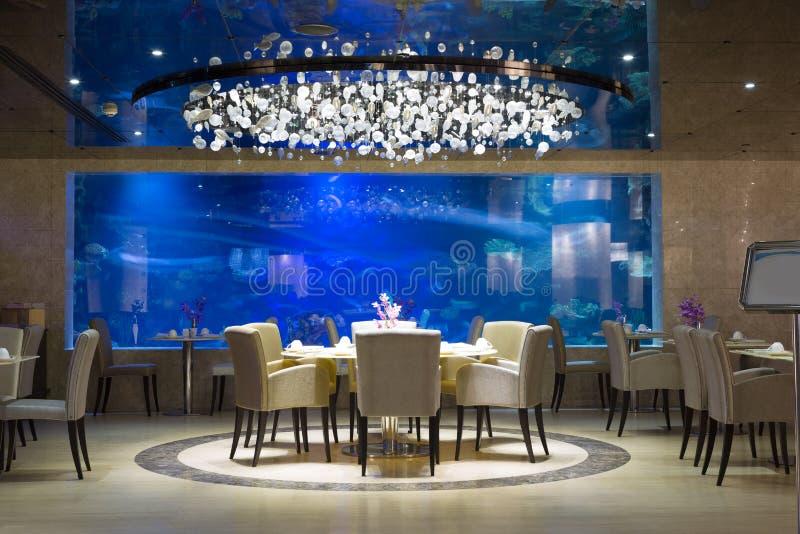 Interior of modern restaurant. Interior of a modern restaurant with aquarium stock photography