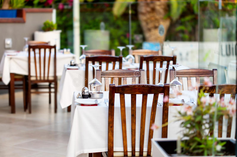Interior of modern restaurant. With the covered tables stock photography