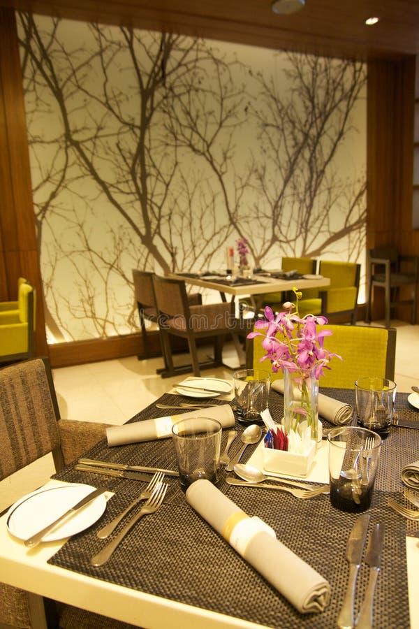 Interior of modern restaurant , empty glass on table. Interior of modern restaurant royalty free stock photography