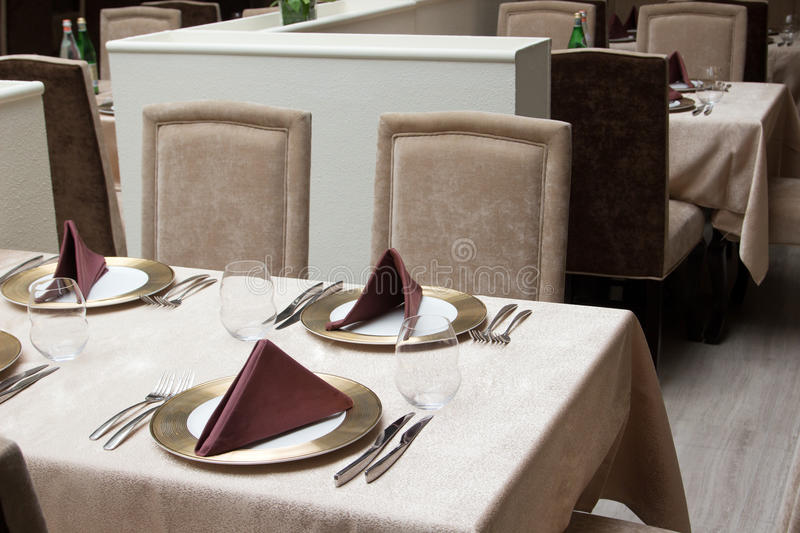 Interior of modern restaurant with served table. For four people royalty free stock images