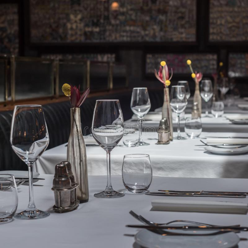 Interior of a modern restaurant with tables served for dinner.  royalty free stock image