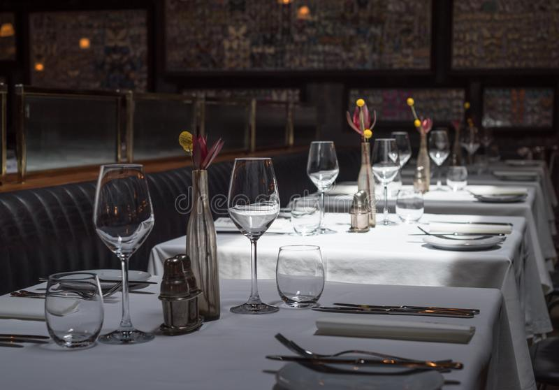 Interior of a modern restaurant with tables served for dinner.  stock photo