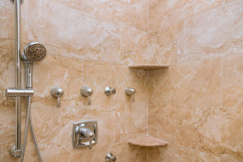 Interior of modern shower head in bathroom at home design of bathroom stock photography